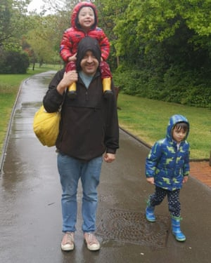 Andrzej Łukowski and sons in Kelsey Park, Beckenham, during a rainy day in lockdown