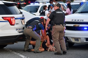 Officers take a protester into custody during a demonstration against police brutality in South Carolina, US