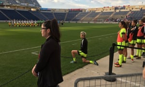 Megan Rapinoe kneeling during the national anthem