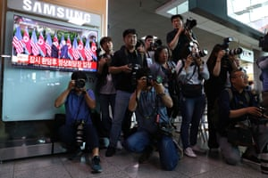 Photographers gather at the Seoul railway station in South Korea.