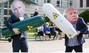 Activists yesterday protesting in Germany the ending of the INF treaty. They are wearing masks depicting Russian president Vladimir Putin and US president Donald Trump, holding mock nuclear missiles.
