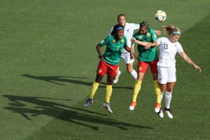 Yvonne Leuko and Estelle Johnson of Cameroon jump for the ball with Rosie White of New Zealand.