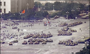 Tanks mass in Tiananmen Square in June 1989 as the Chinese authorities quell the demonstrations.