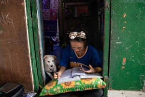 Tending to her family's sidewalk eatery, while completing her assignment, grade 9 student Annie Sabino, 16, said: 'I often wake up late for class from staying up too late finishing online schoolwork, as the signal is better at night.'