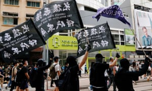 Demonstrators wave pro-democracy flags during a protest in Hong Kong