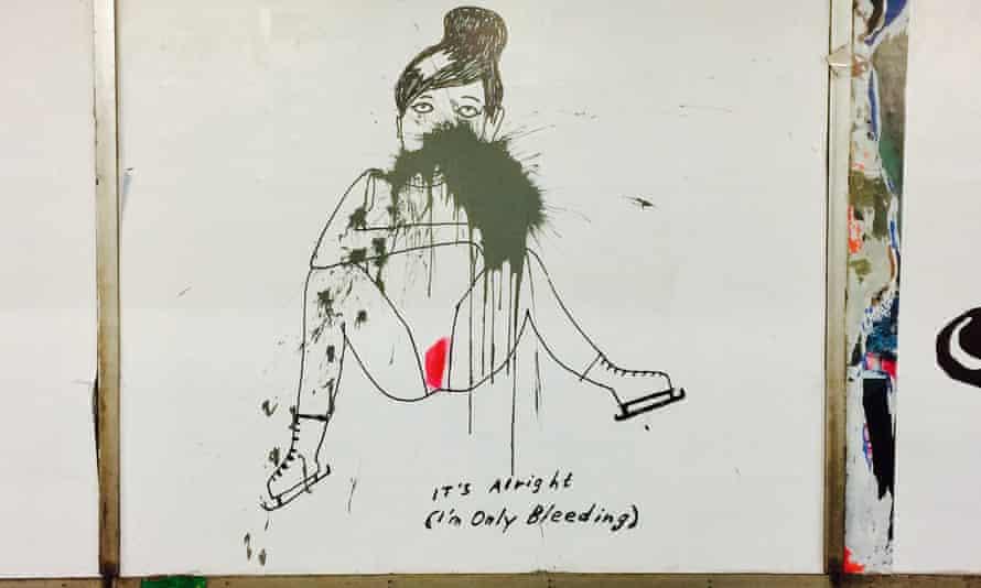 Cartoon of menstruating woman by the comic artist Liv Strömquist at Slussen station, defaced by black paint.
