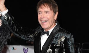 Cliff Richard smiles for the camera at an awards ceremony