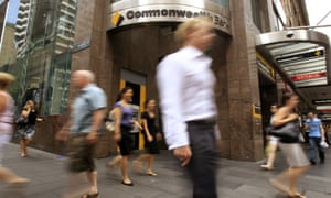 People walk past a Commonwealth Bank branch in Sydney