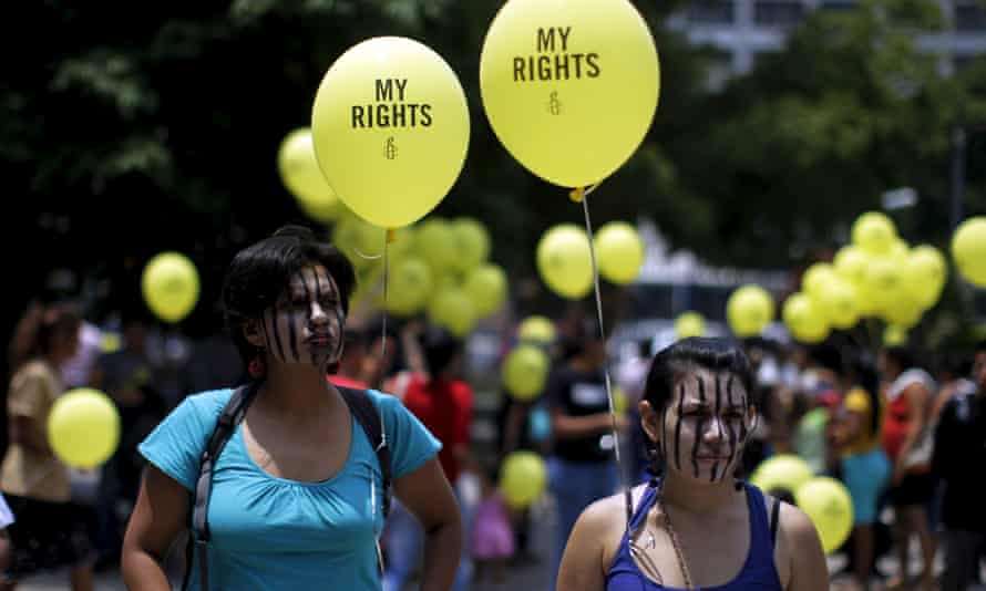 Women take part in a demostration against anti-abortion laws at the congress in San Salvador on 22 April 2015.