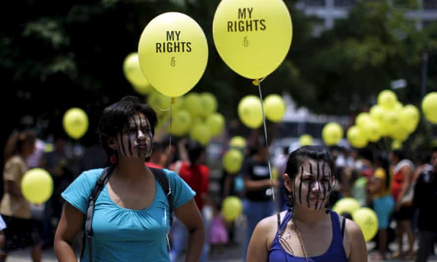 Salvadoran women take part in a demonstration against anti-abortion laws at the congress in San Salvador in April 2015