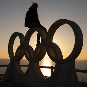 Tom Squires at The Olympic Rings Stone Structure at New Ground in Portland, Dorset during July 2020.