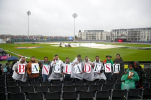 Bangladesh fans find something to do in the rain.