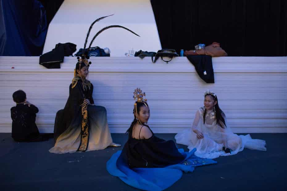 Models wait backstage before a show during fashion week in Beijing, China, 30 October