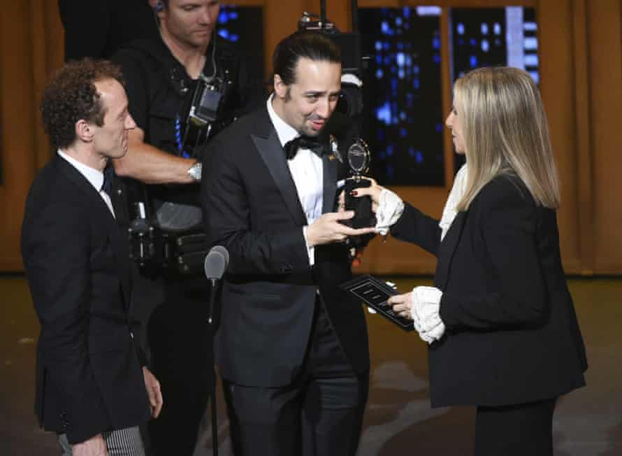 Jeffrey Seller and Lin-Manuel Miranda accepting a Tony award for Hamilton from Barbra Streisand in 2016