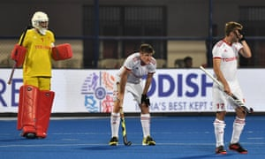 England defenders look dejected as they fell to semi-final defeat for the third hockey World Cup in a row.