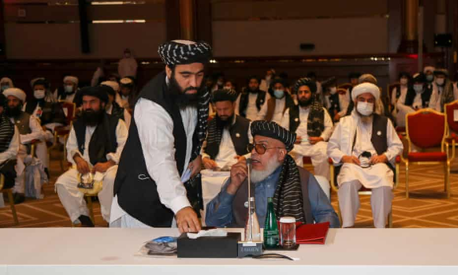 Taliban negotiator Abbas Stanikzai (seated) at the opening of the peace talks in Doha, Qatar, on Saturday