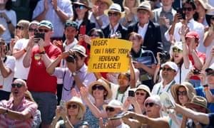 Spectators get into the Wimbledon spirit.