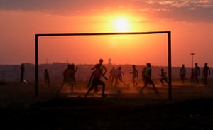 Soweto, South AfricaA game of football is played on a dusty pitch in Soweto township.