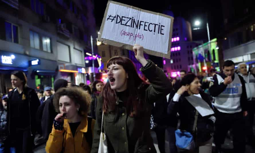 Protesters shout anti-corruption slogans during a march in downtown Bucharest.