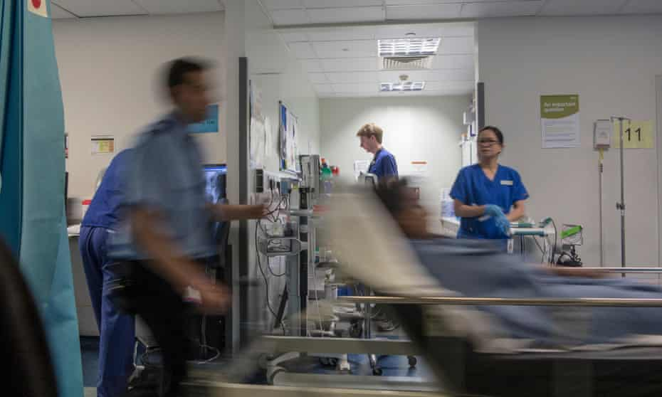 A busy hospital with doctors, nurses and staff busy at work in an accident and emergency ward in a hospital