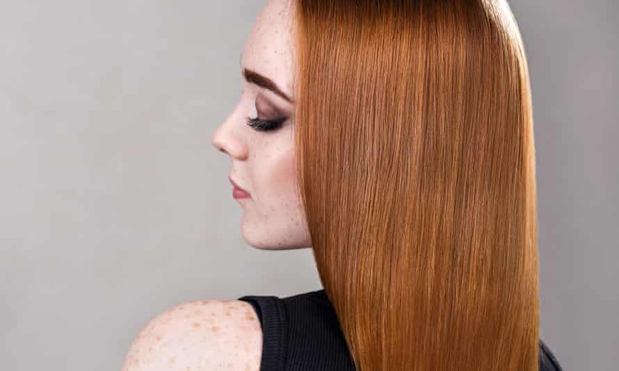 A woman with red hair.
