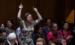 A demonstrator shouts as Judge Brett Kavanaugh arrives for the Senate judiciary committee hearing.