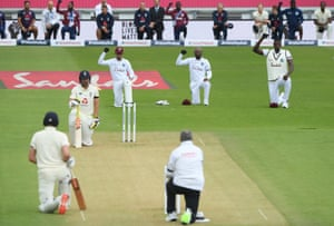 The West Indies' captain, Jason Holder and teammates take a knee before the start of the first Test against England at the Ageas Bowl
