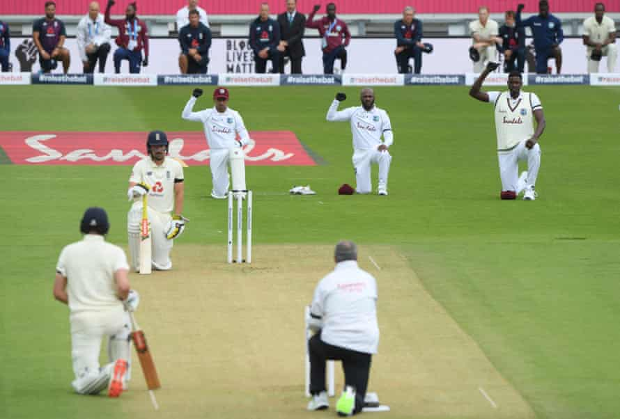 West Indies' Shane Dowrich, Jermaine Blackwood and Jason Holder, plus Rory Burns and Dom Sibley of England, the umpire and support staff, take a knee before the first Test in July