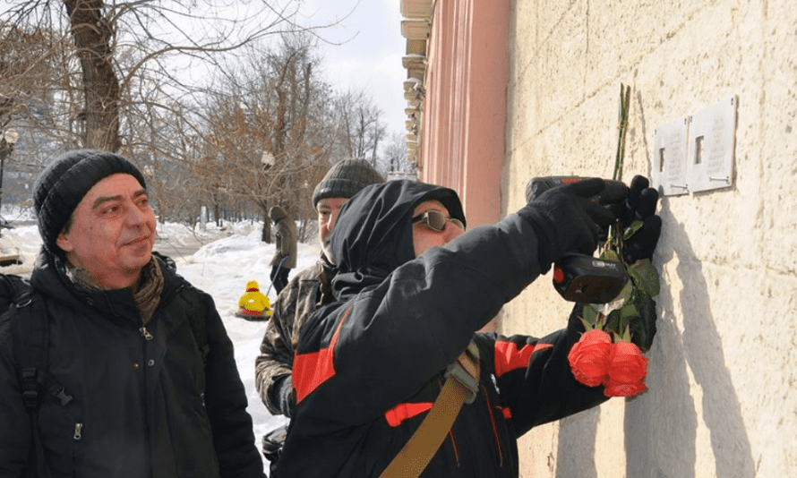 Nikita Sokolov, Russian historian and activist for the Last Address project, watches the installation of a memorial plaque in Moscow.