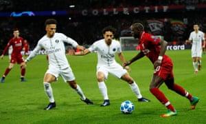 Liverpool's Sadio Mane attempts to go past Paris St Germain's Thilo Kehrer and Marquinhos.