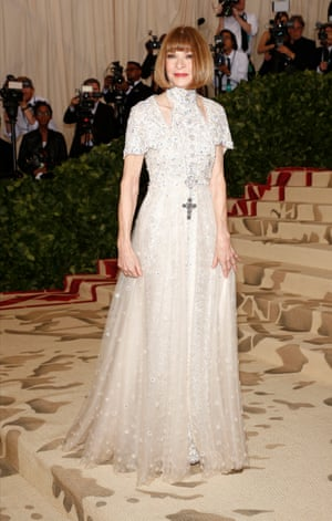 """Fashion's high priestess Anna Wintour arrives at New York's Metropolitan Museum of Art for the annual Costume Institute's benefit gala. The US Vogue's editor in chief and co-chair of the Met Gala stuck closely to the religious Heavenly Bodies theme, dressing as """"Cardinal Chanel""""."""