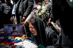 A woman grieves over the coffin of a person killed during the recent clashes.