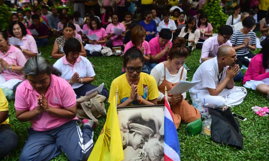 People praying for the king in Bangkok on Thursday.