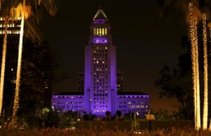 Los Angeles city hall is illuminated purple in remembrance