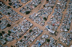 As cities grow - such as this informal settlement outside Johannesburg - the elephant range shrinks.