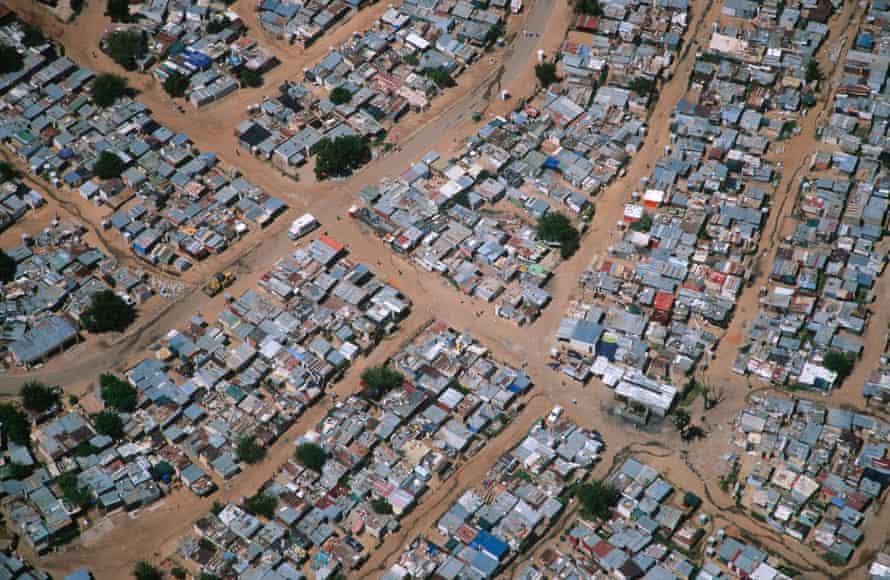 As cities grow - such as this informal settlement outside Johannesburg - the elephant range shrinks.