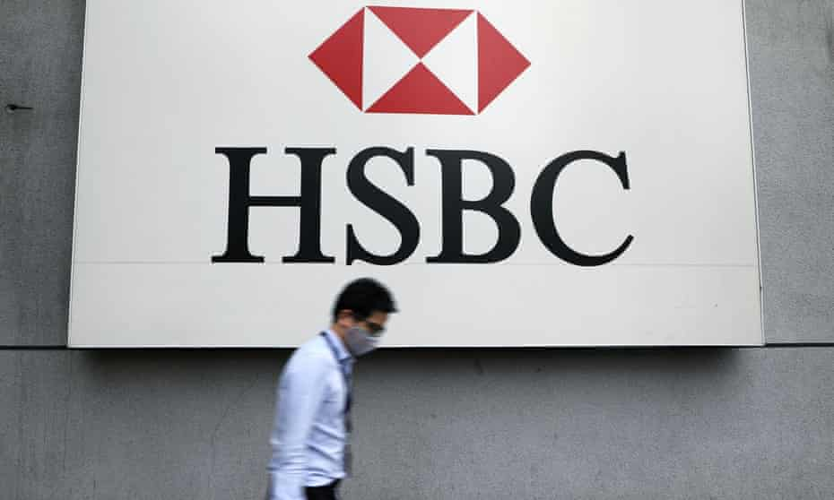 A man wearing a protective mask walks past a logo of HSBC at its headquarters, amid the coronavirus disease (COVID-19) outbreak in Kuala Lumpur, Malaysia, September 2020