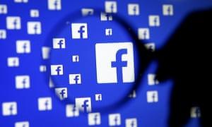 Facebook symbols under magnifying lense