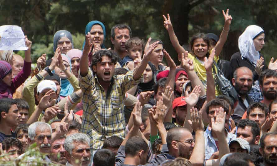 Syrian refugees protest against President Assad in a camp in Turkey, near the Syrian border in 2011