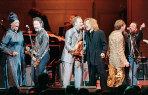 Norman performing with Jon Bon Jovi, Billy Joel, Elton John, Sting and Bruce Springsteen at Rock for the Rainforest, 1995