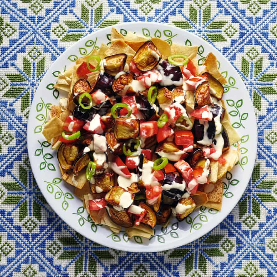 Fried aubergine, tomato and chilli salad with toasted pitta.