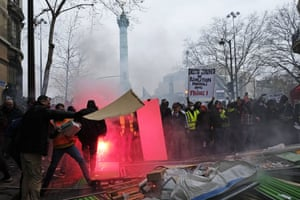 French riot police face yellow protesters in Place de la Bastille last weekend