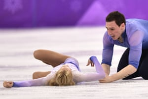 Germany's Aljona Savchenko and Bruno Massot react after completing their routine in the pairs free skate figure skating final.