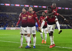 Manchester United's Jesse Lingard celebrates scoring their fifth goal with teammates.