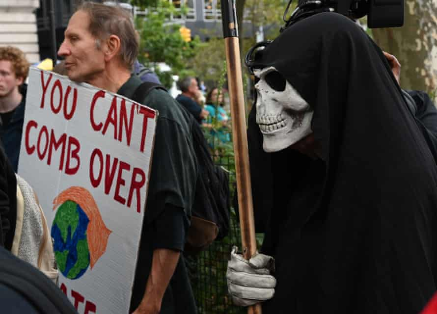 Climate crisis activists gather in Battery Park during Extinction Rebellion demonstrations in New York.