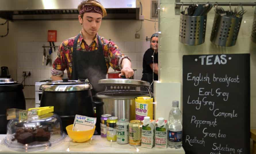 Member of staff serving behind the counter at the Sidney Street Cafe, Manchester