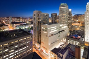 """A view of SFMoMA at night: """"a building-sized baked Alaska slumped on the skyline"""""""