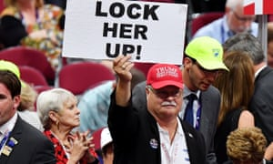 "A Florida delegate holds up a sign that reads ""Lock Her Up"" at the Republican national convention."