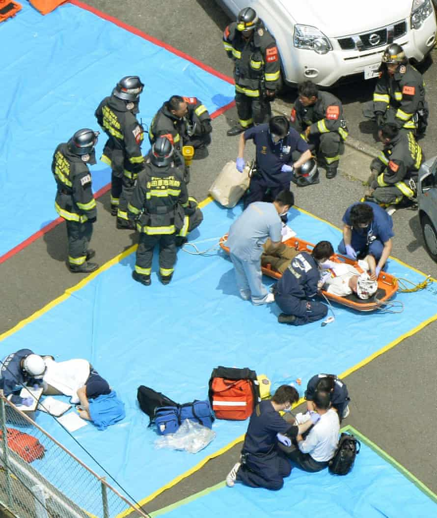 Passengers receive treatment in Odawara, after smoke filled the carriage, forcing the train to stop.