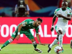 Sadio Mané goes past Riyad Mahrez at the Africa Cup of Nations final.